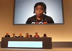 © Licensed to London News Pictures. 28/09/2011. LONDON, UK. Naresa Gordon (pictured on screen) talks about how her family have been affected by knife crime. The Labour Party Conference in Liverpool today (28/09/11). Photo credit:  Stephen Simpson/LNP