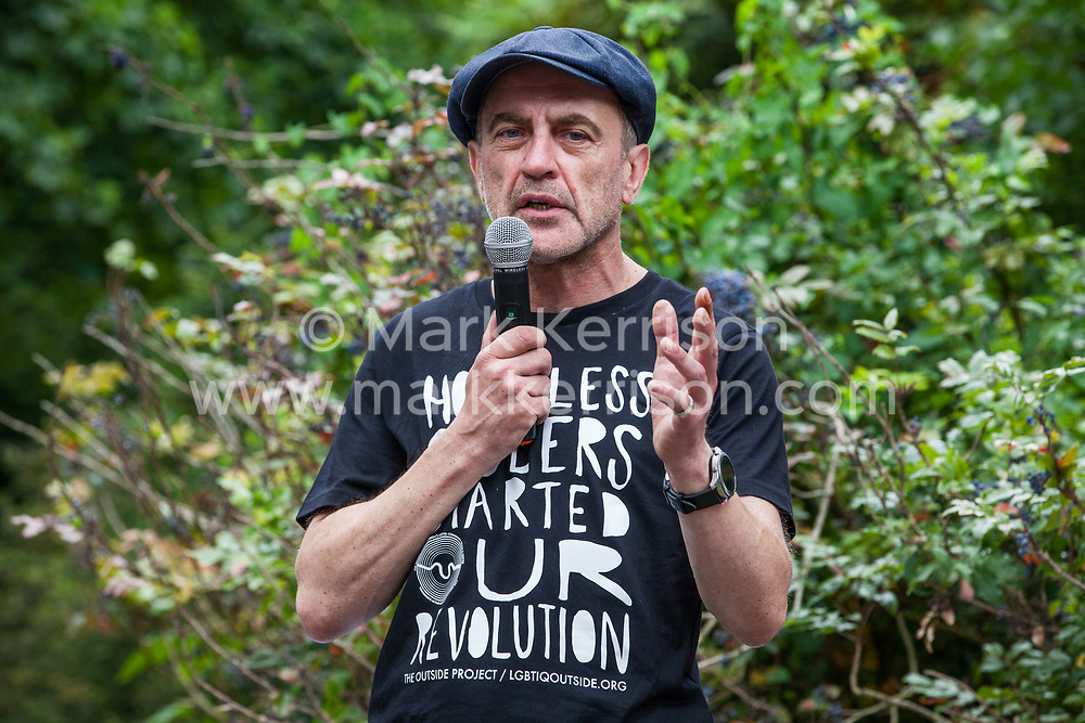London, UK. 6 July, 2019. Jon Glackin of Streets Kitchen addresses activists from Lesbians and Gays Support The Migrants, African Rainbow Family, the Outside Project, Micro Rainbow and other LGBT+ groups preparing to take part in a London Pride Solidarity March in solidarity with those for whom Pride in London is inaccessible and in protest against the corporatisation of Pride in London.
