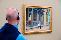 Man looking at painting Sunday by Edward Hopper at exhibition of American art , From Hopper to Rothko at the Barberini Museum in Potsdam , Germany . Editorial Use Only
