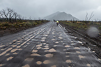 Road full of puddles from a border crossing between Argentina and Chile. This is the Argentinean side