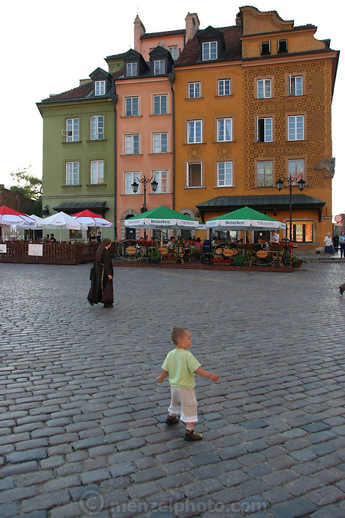 Small boy and old nun, Warsaw Poland, Old Town Square area. Summer evening.