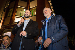 © Licensed to London News Pictures. 04/12/2015. London, UK. JEREMY CORBYN (R) with Mohammed Kozbar (L), chairman of Finsbury Park Mosque speaking at an anti-Islamophobia rally and protest against racism and anti-muslim hate crime, outside the Finsbury Park Mosque in north London. The rally, organised by Finsbury Park Mosque, Stand Up To Racism and Stop The War Coalition follows an attempted arson attack on Finsbury Park Mosque last week and was attended by Labour Party leader and local MP for Islington North, Jeremy Corbyn. Photo credit : Vickie Flores/LNP