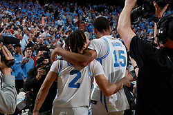 CHAPEL HILL, NC - FEBRUARY 25: Garrison Brooks #15 and Cole Anthony #2 of the North Carolina Tar Heels embrace after a game against the North Carolina State Wolfpack on February 25, 2020 at the Dean Smith Center in Chapel Hill, North Carolina. North Carolina won 79-85. (Photo by Peyton Williams/UNC/Getty Images) *** Local Caption *** Garrison Brooks;Cole Anthony