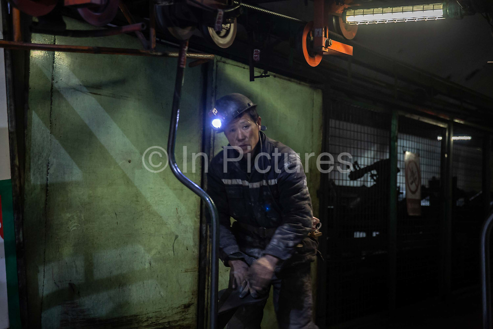 A miner rides a lift up to exit the mine shaft after finishing his shift at a coal mine and processing facility in Liulin, Shanxi province, China, on Thursday, May 19, 2016. Shanxi is facing a challenge shared by a sweeping region across Chinas industrial north: how to shut down cash-burning mines that employ millions of people whose prospects are uncertain in the new economy promised by President Xi Jinping.