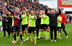 Sheffield United manager Chris Wilder (right), Billy Sharp (centre) and goalkeeper Dean Henderson (left) celebrates promotion to the Premier League after the Sky Bet Championship match at the bet365 Stadium, Stoke.
