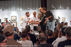 Custom builder Jay Donovan of British Columbia finds out his Yamaha XS-650 on display at the Old Iron - Young Blood just won a trip to be displayed in Verona, Italy for the Motor Bike Expo. Here at the media and industry reception in the Motorcycles as Art gallery at the Buffalo Chip during the annual Sturgis Black Hills Motorcycle Rally. Sturgis, SD. USA. Sunday August 6, 2017. Photography ©2017 Michael Lichter.