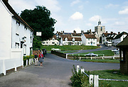 Historic buildings and cars in pretty village of Finchingfield, Essex, England 1964