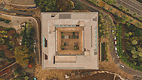 Aerial view of abstract beautiful rectangular house with patio surrounded by colourful green trees in Malaga, Spain