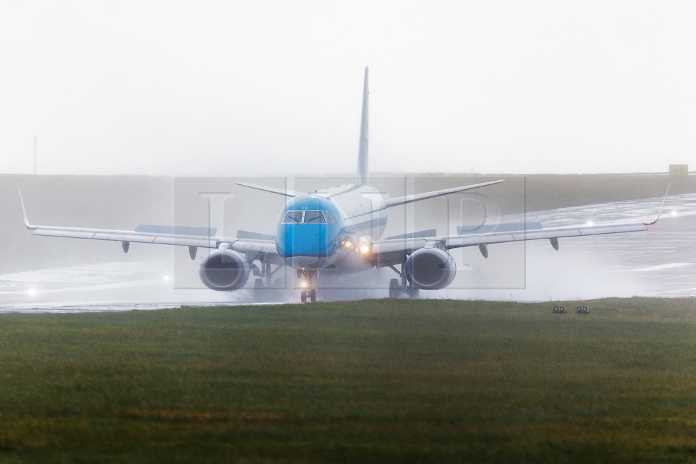 © Licensed to London News Pictures. 10/03/2020. Leeds UK. A KLM aircraft is engulfed in water as it lands in the strong winds & rain this morning at Leeds Bradford airport in Yorkshire as the UK is battered by more bad weather. Photo credit: Andrew McCaren/LNP