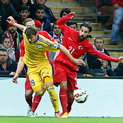 Turkey's Olcay Sahan (R) and Kazakhstan's Stanislav Lunin (L) during their UEFA Euro 2016 qualification Group A soccer match Turkey betwen Kazakhstan at AliSamiYen Arena in Istanbul November 16, 2014. Photo by Kurtulus YILMAZ/TURKPIX