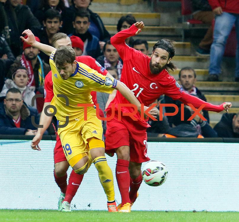 Turkey's Olcay Sahan (R) and Kazakhstan's Stanislav Lunin (L) during their UEFA Euro 2016 qualification Group A soccer match Turkey betwen Kazakhstan at AliSamiYen Arena in Istanbul November 16, 2014. Photo by Kurtulus YILMAZ/TURKPIX