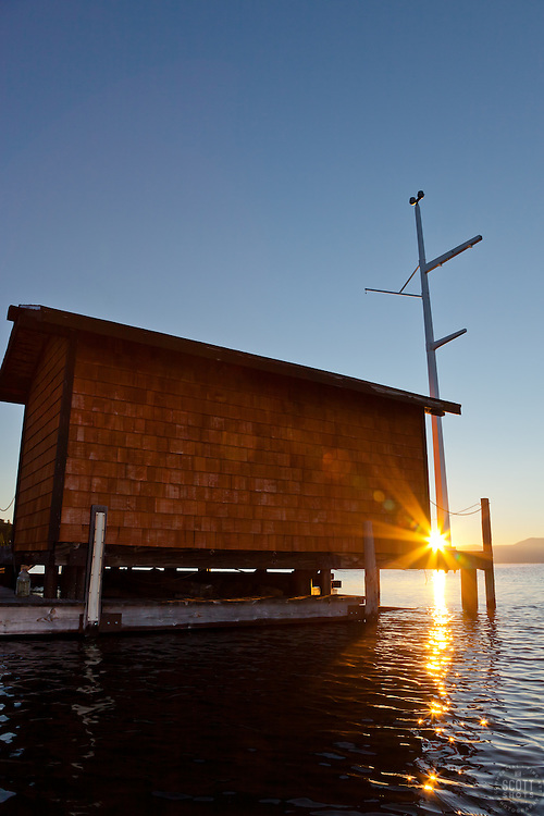 """""""Tahoe City Pier at Sunrise 4"""" - This small building on the end of a pier was photographed at sunrise near Commons Beach, Lake Tahoe. Photographed from a kayak."""