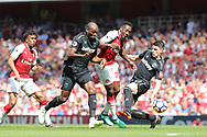 Arsenal forward Danny Welbeck (23) is sandwiched by West Ham United defender Angelo Ogbonna (21) & West Ham United midfielder Declan Rice (41) during the Premier League match between Arsenal and West Ham United at the Emirates Stadium, London, England on 22 April 2018. Picture by Bennett Dean.