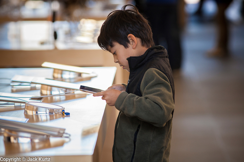 16 MARCH 2012 - SCOTTSDALE, AZ:  JON SPEEDIE, 7, plays with the New iPad in the Apple Store in Scottsdale while his father (not in photo) waits to buy Apple's newest consumer device. Several hundred people were in line at the Apple Store in the Scottsdale Quarter in Scottsdale, AZ, Friday to buy the New iPad.    PHOTO BY JACK KURTZ