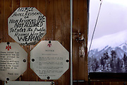Gulmarg, Kashmir. In the lobby of the Hotel Highlands Park resisdents are asked to not enter the public rooms with weapons. Gulmarg has the worlds highest gondola (3980m) which opened in 2005 and has been drawing snowboarders and skiers from around the world. Gulmarg is only 10km from the line of control that seperates Pakistan Kashmir from Indian Kashmir which means its situated in a conflict zone. But improved relations between the two countries as well as a peace process within Kashmir have meant more skiers are now flocking to the area for what is said to be some of the best skiing in the world.