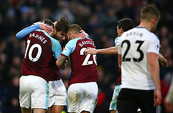 Burnley's Jeff Hendrick (centre) celebrates his side's first goal of the game with team-mates Ashley Barnes and Phil Bardsley during the Premier League match at Turf Moor, Burnley.