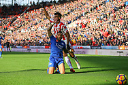 Danny Simpson of Leicester City tackles Eric Maxim Choupo-Moting of Stoke City. Premier league match, Stoke City v Leicester City at the Bet365 Stadium in Stoke on Trent, Staffs on Saturday 4th November 2017.<br /> pic by Chris Stading, Andrew Orchard sports photography.