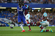 Ngolo Kante of Chelsea runs past Andre Ayew of West Ham United and Cheikhou Kouyate of West Ham United. Premier league match, Chelsea v West Ham United at Stamford Bridge in London on Monday 15th August 2016.<br /> pic by John Patrick Fletcher, Andrew Orchard sports photography.