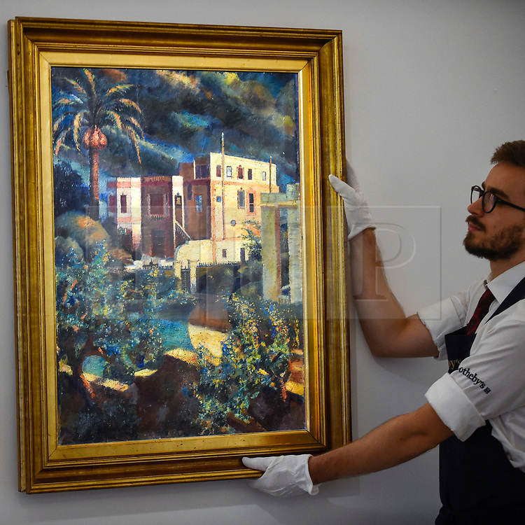 """© Licensed to London News Pictures. 18/10/2019. LONDON, UK. A technician presents """"After the Rain"""", 1936, by Mahmoud Said (Est. GBP300,000-400,000).  Preview of Islamic, Indian and Middle Eastern art to be auctioned at Sotheby's, New Bond Street, on 22 and 23 October.  Photo credit: Stephen Chung/LNP"""