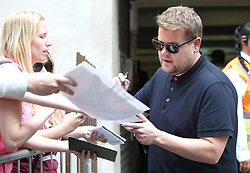 James Corden signing autographs for fans during filming for The Late Late Show, at Methodist Central Hall, London.