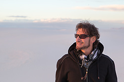 man with sunglasses and messy hair outdoors