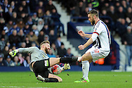 Peterborough goalkeeper Ben Alnwick (l) is challenged by West Brom's Rickie Lambert. The Emirates FA Cup, 4th round match, West Bromwich Albion v Peterborough Utd at the Hawthorns stadium in West Bromwich, Midlands on Saturday 30th January 2016. pic by Carl Robertson, Andrew Orchard sports photography.