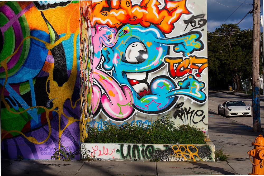 A Ferrari in Miami's mural-filled Wynwood district