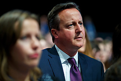© Licensed to London News Pictures. 05/10/2015. Manchester, UK. Prime Minister David Cameron listening Chancellor of Exchequer George Osborne speaking at Conservative Party Conference at Manchester Central in Manchester on Monday, 5 October 2015. Photo credit: Tolga Akmen/LNP