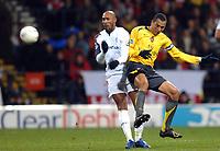 Photo: Paul Greenwood.<br />Bolton Wanderers v Arsenal. The FA Cup. 14/02/2007. Bolton's Nicolas Anelka, left and Arsenal's Gilberto collide