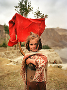 A Wakhi girl in Passu area, in upper Hunza. People and places of the Hunza Valley, in the heart of the Karakoram mountain Range, North Pakistan.