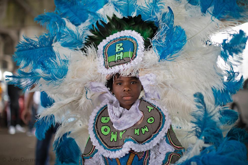 9th Ward Black Hatchet Mardi Gras Indians under the Claiborne expressway overpass on Mardi Gras day in New Orleans.