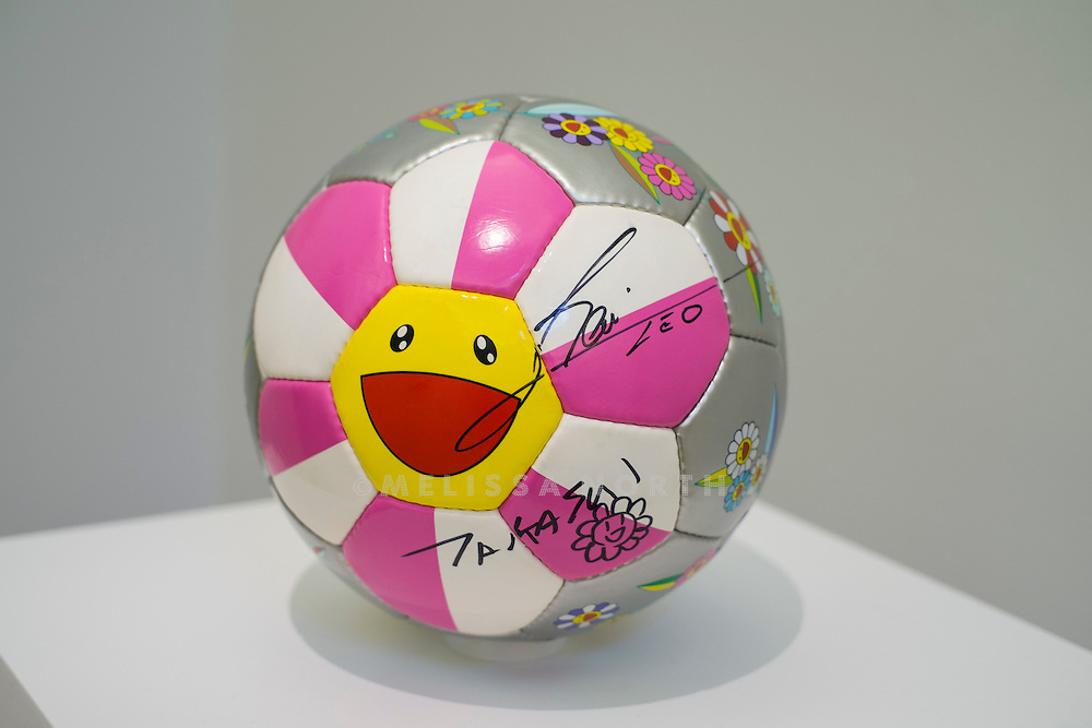 TAKASHI MURAKAMI - Flower Ball, signed by Lionel Messi and Takashi Murakami. From 'The Art of Football' highlights from celebrated artists due to be auctioned on 12th February 2015, donated in support of the 1 in 11 Campaign by FC Barcelona, Reach Out to Asia (ROTA) and UNICEF, at Sotheby's, London, UK on 6th February 2015.