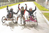 Blue Peter presenters have gone head-to-head on their personally modified bikes in a cycle race for Sport Relief 2014.  Pictured, from left, Radzi Chinyanganya, Barney Harwood and Lindsey Russell <br /> <br /> Photo by Chris Vaughan/CameraSport<br /> <br /> Commercial - Sport Relief -  publicity shoot - Tuesday 4th March 2014 - University of Central Lancashire Sports Arena - Preston<br /> <br /> © CameraSport - 43 Linden Ave. Countesthorpe. Leicester. England. LE8 5PG - Tel: +44 (0) 116 277 4147 - admin@camerasport.com - www.camerasport.com