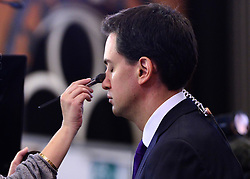 © Licensed to London News Pictures. 03/10/2012. Manchester, UK Ed Miliband, Labour Party leader has make up applied before giving a television interview on Day 4 at The Labour Party Conference at Manchester Central today 3rd october 2012. Photo credit : Stephen Simpson/LNP
