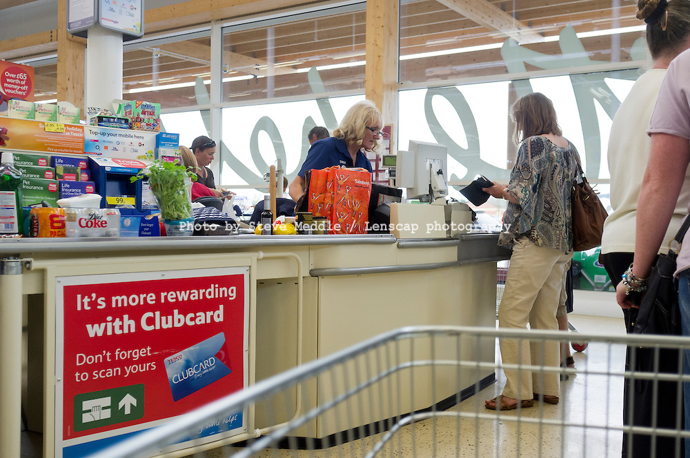 Customer Paying for Shopping at Checkout, Tesco Supermarket.
