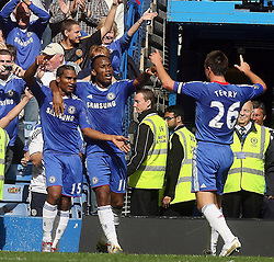 28.08.2010, Stamford Bridge, London, ENG, PL, Chelsea FC vs Stoke City, im Bild Florent Malouda of Chelsea  celebrates with Didier Drogba and John Terry, EXPA Pictures © 2010, PhotoCredit: EXPA/ IPS/ M. Pozzetti *** ATTENTION *** UK AND FRANCE OUT! / SPORTIDA PHOTO AGENCY
