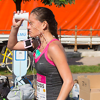 Participant cools off with a glass of water at a refreshing point during the Budapest Half Marathon in Budapest, Hungary on September 13, 2015. ATTILA VOLGYI