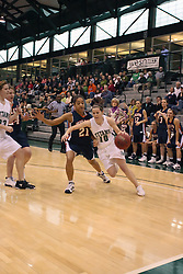 10 January 2009: Kathleen Fidelia can't get in front of Claire Sheehan who turns the baseline corner and heads for the paint. The Lady Titans of Illinois Wesleyan University downed the and Lady Thunder of Wheaton College by a score of 101 - 57 in the Shirk Center on the Illinois Wesleyan Campus in Bloomington Illinois.