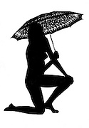 Silhouette of a nude woman with an umbrella