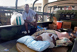 30 August, 2005. New Orleans Louisiana. Hurricane Katrina aftermath. <br /> A daughter looks over her sickly mother at the makeshift hospital triage unit set up at the Superdome in New Orleans following her evacuation from the catastrophic floods of the lower 9th ward. <br /> Photo Credit: Charlie Varley/varleypix.com