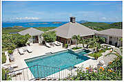 Lockdown in paradise as Kate jets in for Middleton family holiday<br /> <br /> It has long been an idyllic retreat for the rich and famous – so you wouldn't think the presence of Royalty would cause a stir.<br /> But the arrival of the Duchess of Cambridge and her family on the privately owned island of Mustique has upset fellow holidaymakers.<br /> Heightened security measures to ensure Kate's privacy mean the Mustique Company, which owns the Caribbean island, is restricting the movements of other guests.<br /> Tourists have been told that if they wish to dine at one of the island's two hotels they must travel in a vehicle provided by the venue.<br /> They are banned from using the rented 'mules' – the island's fleet of souped-up golf carts – in case they try to take pictures at the Middleton family's £15,000-a-week Aurora villa, featuring its own plunge pool and a stunning ocean view. <br /> There have also been reports of guests being quizzed by security men while walking on the beach.<br /> One local millionaire, who asked not to be named, said: 'This isn't exactly the way one expects to be treated when you pay very good money to visit the most exclusive island in the Caribbean.'<br /> Kate's party, which includes her parents Michael and Carole, sister Pippa and younger brother James, is staying at the villa owned by Mark Cecil, a hedge fund manager and friend of the family. Prince William is expected to join them shortly.<br /> <br /> A security source on the island said the new arrangements had been put in place after discussions with the Duchess's British team of bodyguards.<br /> 'The concern isn't crime,' the source said. 'It is that visitors might try to take photos of the VIPs who are here on their phones.'<br /> Photo Shows: Aurora Villa on the island of Mustique. Kate Middleton (Catherine Cambridge) and her mother, father, brother and sister Pippa are rumoured to be holidaying. Prince William to join them later.<br /> ©Exclusivepix