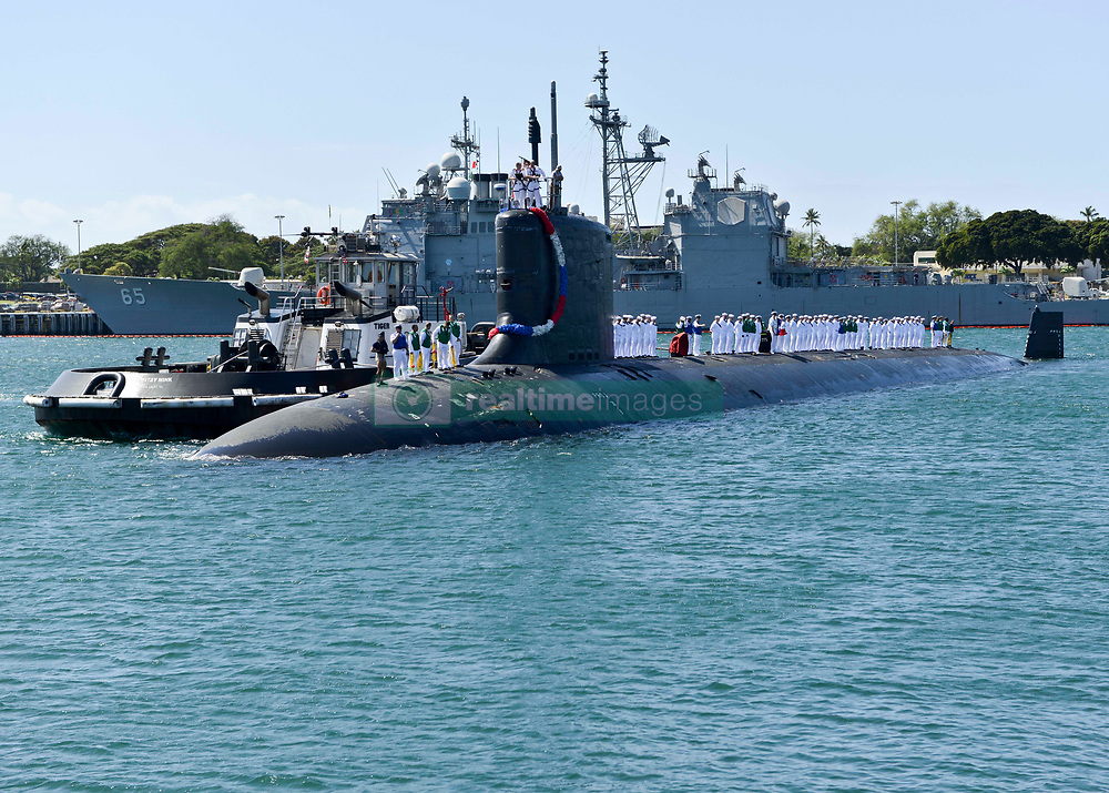 PEARL HARBOR (March 9, 2016) Sailors stand topside aboard the Virginia-class fast-attack submarine USS Texas (SSN 775) as the boat returns home to Pearl Harbor after completing a scheduled western Pacific deployment. (U.S. Navy photo by Mass Communication Specialist 2nd Class Michael H. Lee/Released)<br />160309-N-LY160-104<br />Join the conversation:<br />http://www.navy.mil/viewGallery.asp<br />http://www.facebook.com/USNavy<br />http://www.twitter.com/USNavy<br />http://navylive.dodlive.mil<br />http://pinterest.com<br />https://plus.google.com
