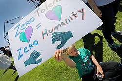 Twelve-year-old Zachary Gottschalk of Portola Valley in Northern California was one of the hundreds of people to protest the Donald Trump administration's immigration policies at Cannon Park in Carlsbad, Calif., on Saturday, June 30, 2018. Photo by Howard Lipin/San Diego Union-Tribune/TNS/ABACAPRESS.COM