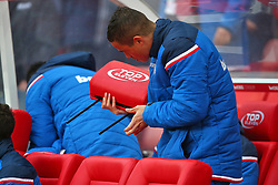 Stoke City's Ibrahim Afellay removes headrests from the seats in the dougout for a better view of the game before the Premier League match at the bet365 Stadium, Stoke-on-Trent.