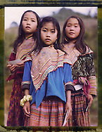 Polaroid 79 portrait of three young girls wearing traditional Hmong clothing, Ha Giang Province, Northern Vietnam, Southeast Asia