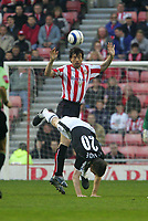 Photo: Andrew Unwin.<br /> Sunderland v Fulham. The Barclays Premiership. 04/05/2006.<br /> Fulham's Brian McBride (#20) falls as Sunderland's Gary Breen wins the ball in the air.