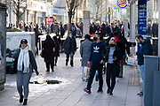 People out and about visiting the shops in the City Centre as tier three / very high alert level of the Coronavirus tier system continues during the run up to Christmas on 14th December 2020 in Birmingham, United Kingdom. After 9 months of lockdown in various forms, people are used to navigating the rules of shopping safely as all non-essential shops try to increase their takings and onwards to the national economy.