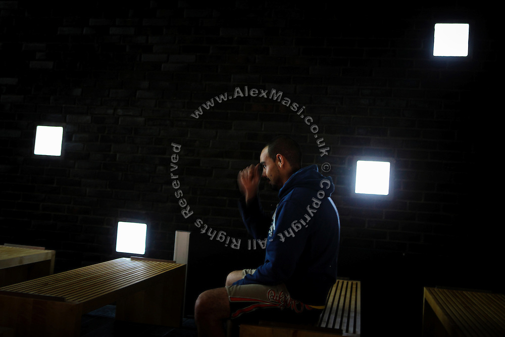 A Christian inmate is praying while sitting inside an area of the prison built purposely for prisoners wanting to express their faith inside the luxurious Halden Fengsel, (prison) near Oslo, Norway.