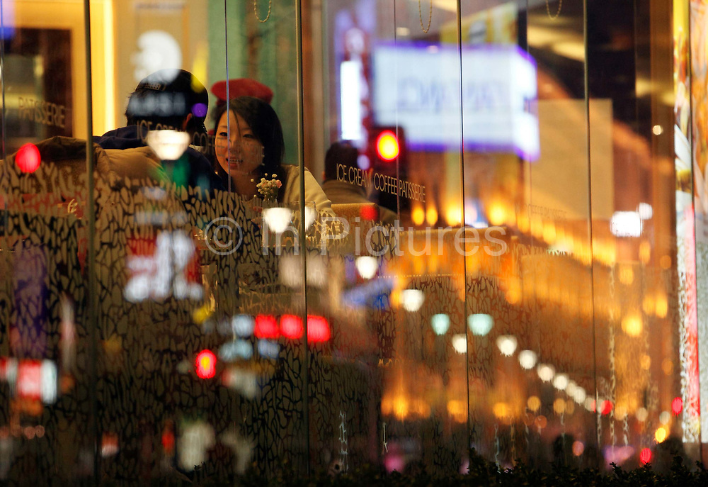Customers at a coffee shop in Shanghai, China on 29 December, 2009.