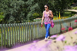 © Licensed to London News Pictures. 18/07/2016. Batley, UK. A summery looking woman enjoys the high temperatures and sunny weather at Golden Achre park in Leeds West Yorkshire.The UK is set to experience a mini heatwave over the next week with temperatures hitting the highest of the year so far.  Photo credit : Ian Hinchliffe/LNP
